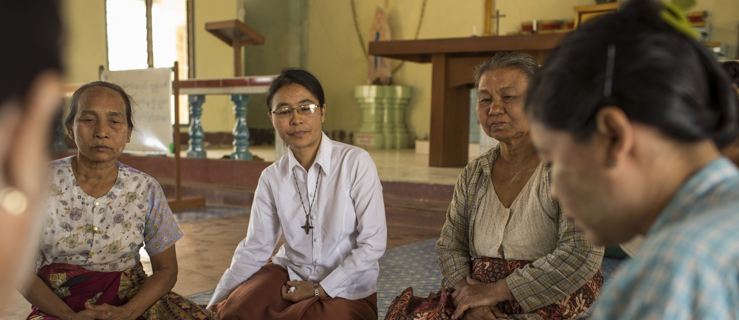 RNDM Sister Angela Shwe Mya helps to run the Sister's microcredit program. She sits and talks with women from Donthalon, an Ethnic Chin village who are active members of their communities group. The women meet regularly in the towns Catholic Church to talk about their lives and how the program has benefited them.