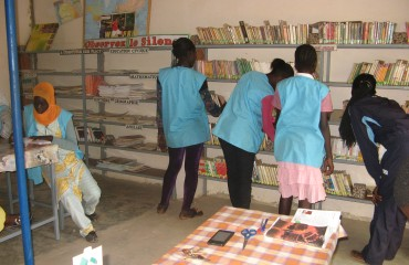 Students searching for book - library Ndondol